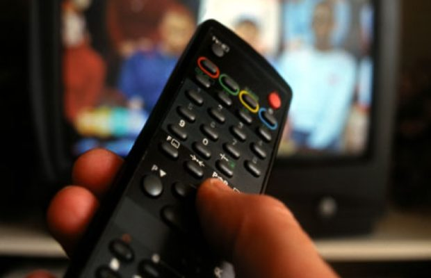 Hand-holding-TV-remote-co-007